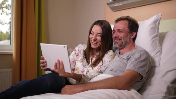 Thumbnail for Married Couple Chatting Online on Tablet in Clinic