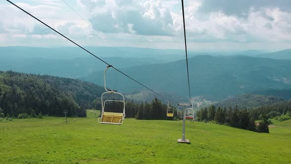 Thumbnail for View From the Chair of the Cable Car on the Panorama of the Mountains on a Summer Sunny Day