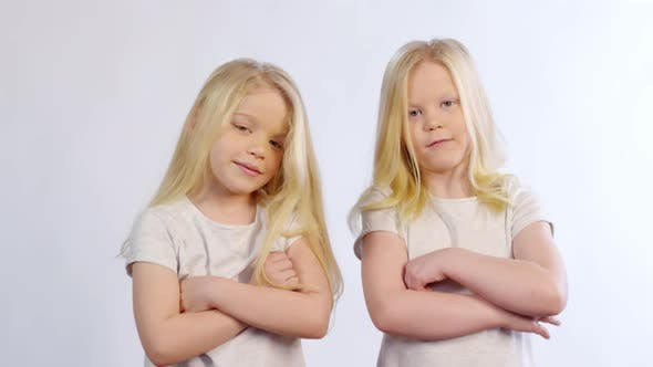 Cover Image for Twin Girls Posing with Crossed Arms