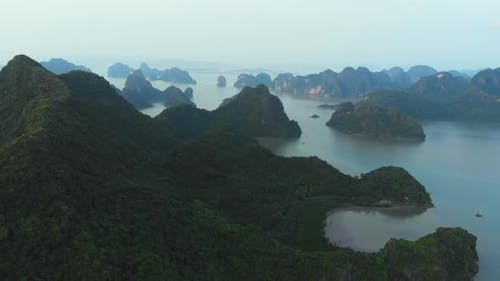 Aerial: unique flying over Ha Long Bay and Cat Ba island, Vietnam