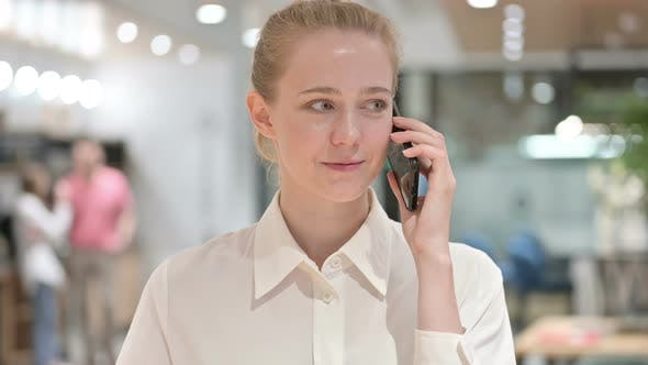 Thumbnail for Portrait of Cheerful Young Businesswoman Talking on Smartphone