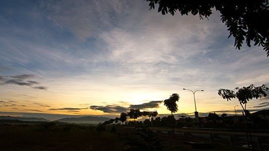 Thumbnail for Blue Sky Sunrise Time Lapse Wide Shot - 4K Res