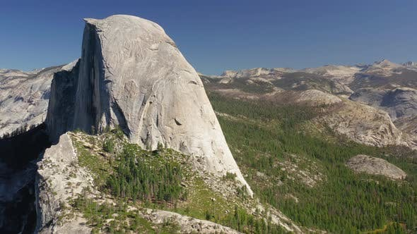 Thumbnail for Half Dome Rock. Popular Symbol of Yosemite National Park, USA. Side Close-up Aerial Footage