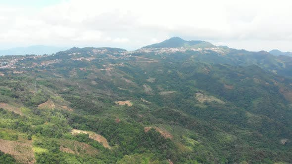 Thumbnail for Unique aerial view of tea plantation on hill and tea pickers village on ridge