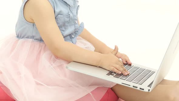 Thumbnail for Little Girl Types the Text on the Keyboard. White Background