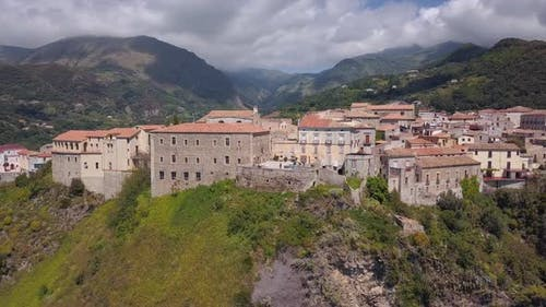 Aerial Medieval City on Hill Overlooking Sea Coast, Village and Mountains, Sunny Day Calabria, Italy
