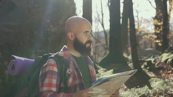 Traveler Holds a Tourist Map in His Hands