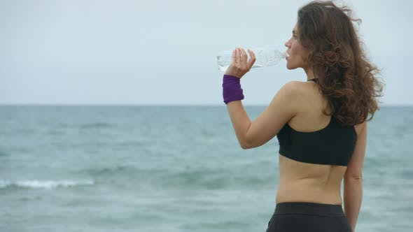 Thumbnail for Young Sportswoman Feels Thirsty After Workout, Drinking Fresh Water From Bottle