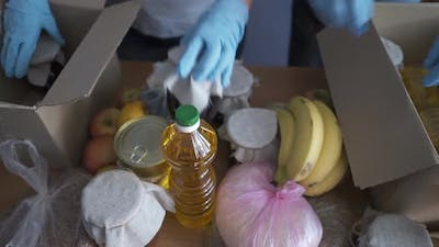 Volunteers in Protective Suits Pack Products