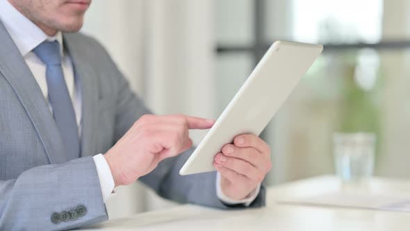 Close Up of Businessman Using Digital Tablet