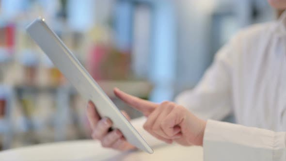 Close Up Woman Typing on Tablet Kept on Table