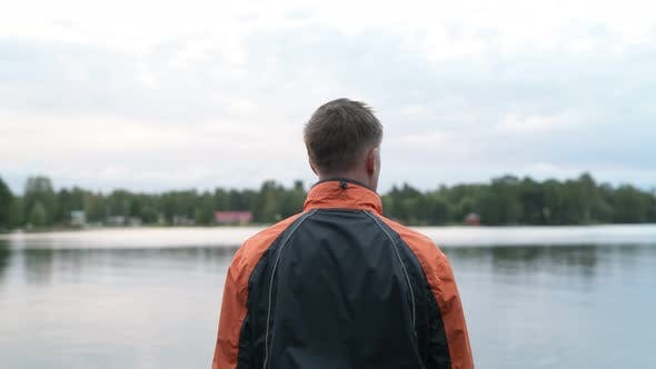 Thumbnail for Rear View Of Young Man Enjoying The View Of The Lake