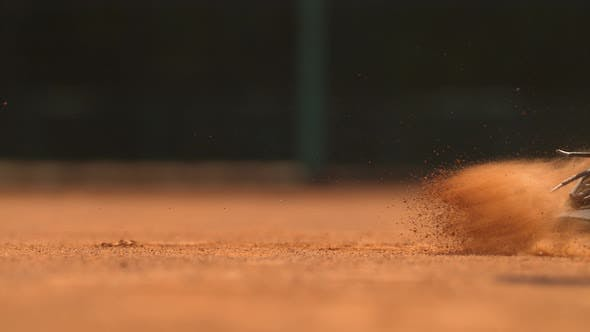 Thumbnail for Legs of a tennis man sliding on the ground, Ultra Slow Motion