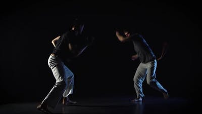 Two Men Are Performing Martial Art of Capoeira.