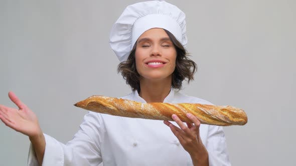 Thumbnail for Happy Female Chef with French Bread or Baguette