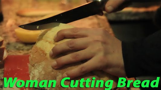 Thumbnail for Woman Cutting Bread