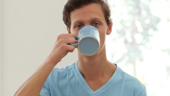 Portrait of Man Drinking Coffee, Taking a Sip