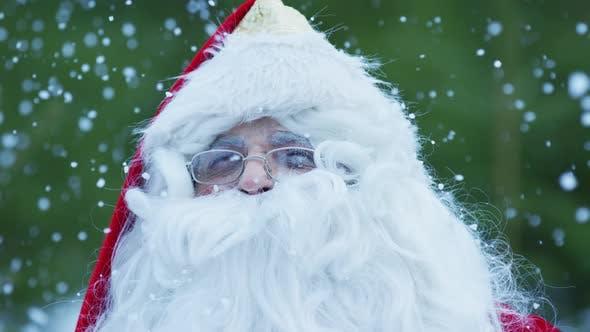 Close up of Santa Claus admiring the snowfall