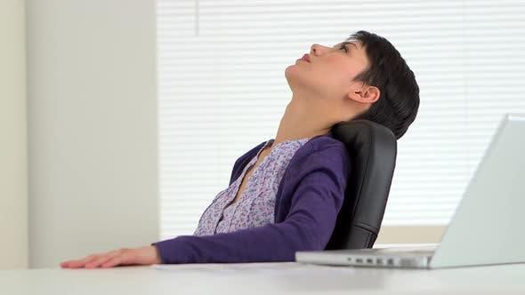 Thumbnail for Asian businesswoman taking a break at work