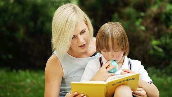 Thumbnail for Down Syndrome Boy With Mother Reading Book