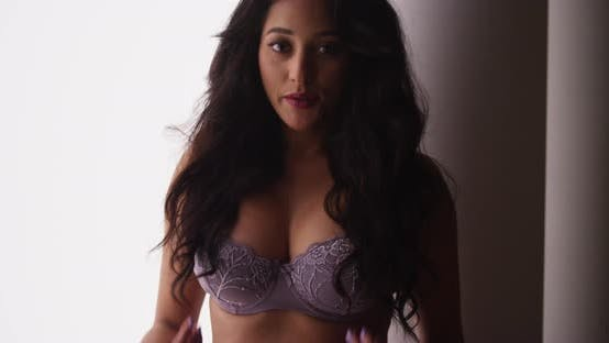 Thumbnail for Mexican woman in lingerie standing and playing with hair