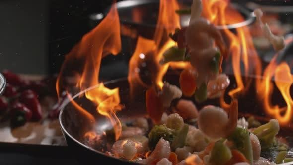 Thumbnail for Stir fry into flaming pan in super slow motion, shot on Phantom Flex 4K