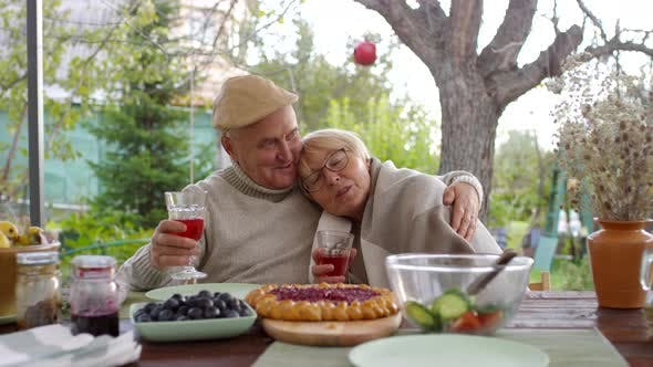 Thumbnail for Loved-Up Elderly Caucasian Couple Sitting in Garden and Hugging