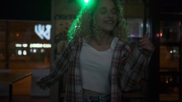 Thumbnail for Cute Girl Dancing Alone at a Party in a Nightclub in the Rays of Spotlights