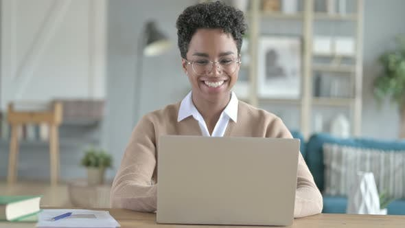 Ambitious African Girl Doing Video Chat on Her Laptop