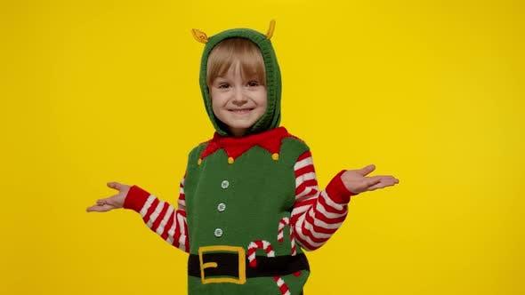 Shocked Kid Girl in Christmas Elf Santa Helper Costume