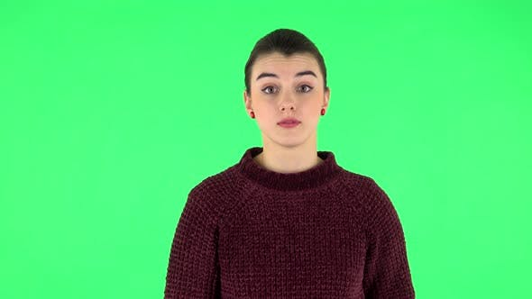 Thumbnail for Girl Talks About Something Then Making a Hush Gesture, Secret. Green Screen