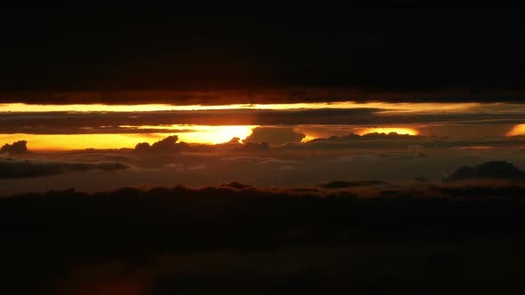 Cover Image for Plane Window View Above The Clouds into The Sunset