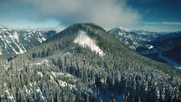 Thumbnail for Snowy Mountain Range Rising Aerial Reveal Early Winter
