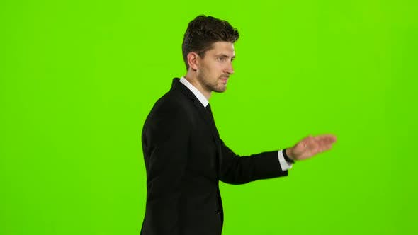 Thumbnail for Man Is Going To a Business Meeting and Waving Greetings. Green Screen. Side View