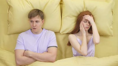 Couple Arguing at Night on Bed Male is Dissatisfied with Wife Behavior