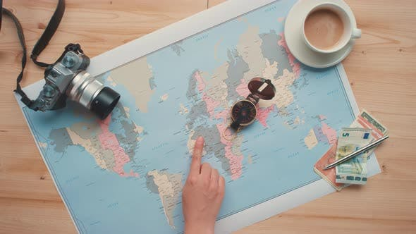 Final Travel Preparations Looking At Map
