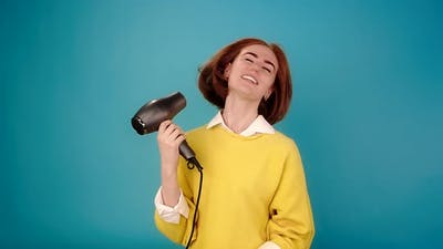 Model with Hair Waved By Hairdryer