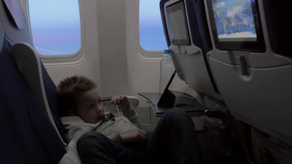 Thumbnail for Child Watching Cartoon on Smartphone in Airplane
