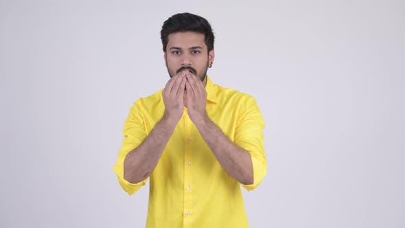 Thumbnail for Young Happy Bearded Indian Businessman Explaining Something