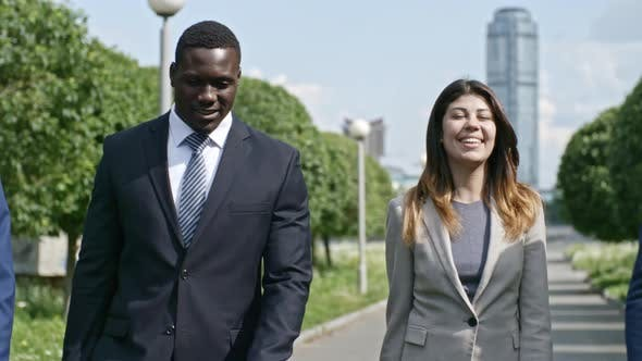 Cover Image for Mixed-Raced Team Walking in City Park