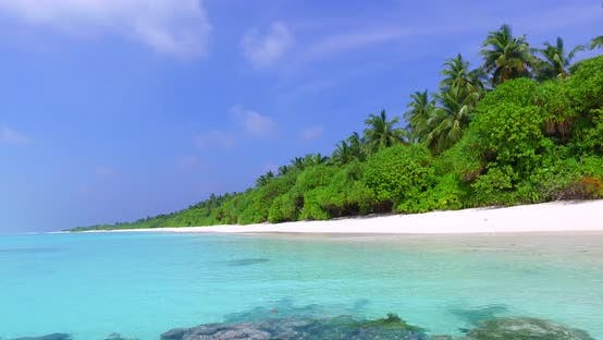 Thumbnail for Wide fly over island view of a summer white paradise sand beach and turquoise sea background in best