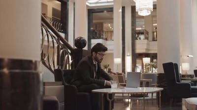 Businessman Using Computer at Table