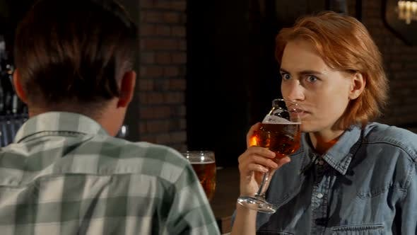 Thumbnail for Woman Looking Surprised While Talking To a Man at the Bar