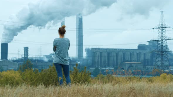 Thumbnail for Girl on the Background Industry Pipes Pollute the Atmosphere With Smoke