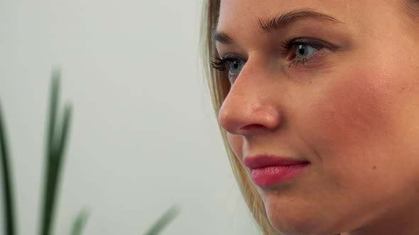 Cover Image for The Profile of a Young, Beautiful Female Face While She Works on a Computer - Closeup