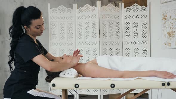 Thumbnail for Focused Female Masseur Making Massage for Young Client