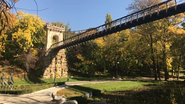 Thumbnail for High suspension bridge in the park slow pan 3840X2160 UltraHD  footage - Autumn in Romanian city of