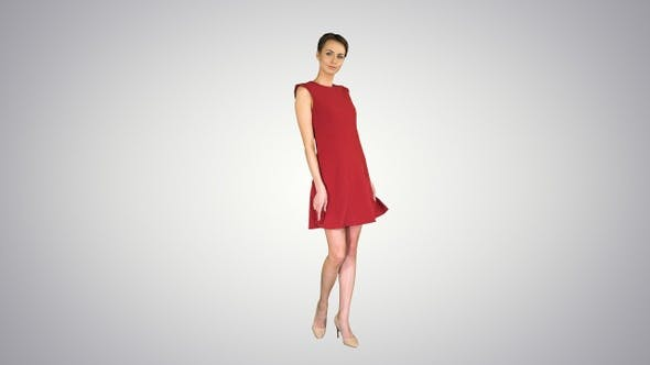Thumbnail for Beautiful young woman with short hair in red dress posing