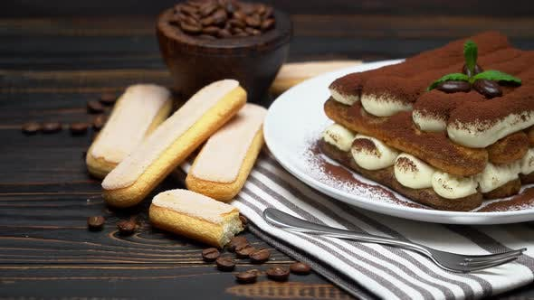 Thumbnail for Classic Tiramisu Dessert and Savoiardi Cookies on Ceramic Plate on Wooden Background