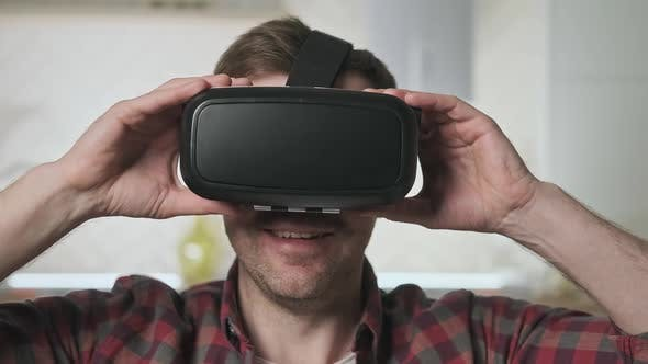 Man Wearing VR Headset at Living Room